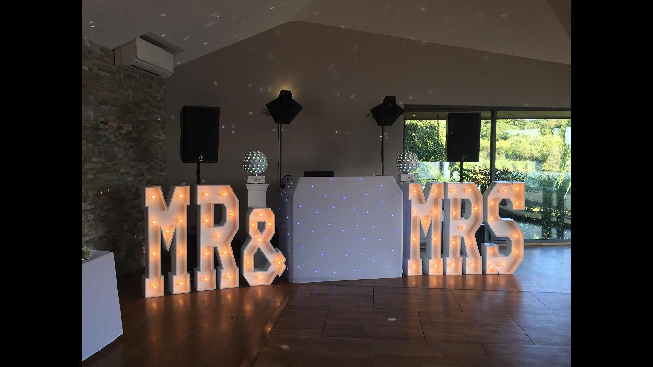 Mr & Mrs Letters set amongst Disco at boathouse