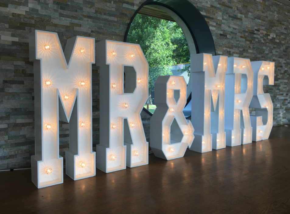 Mr & Mrs Letters set at the boathouse