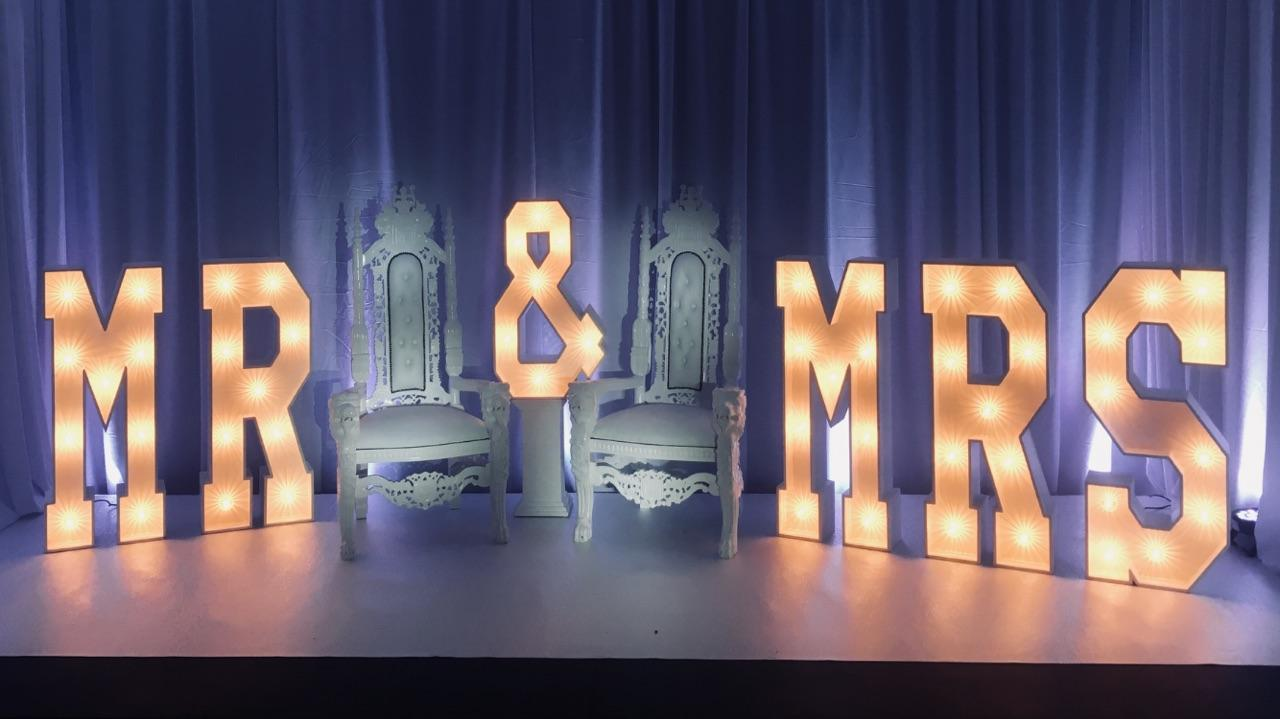 Letters and chairs on stage
