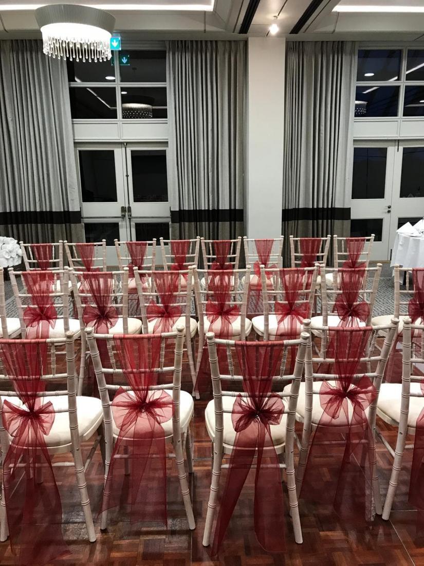red sash drape on limewash chiavari chair