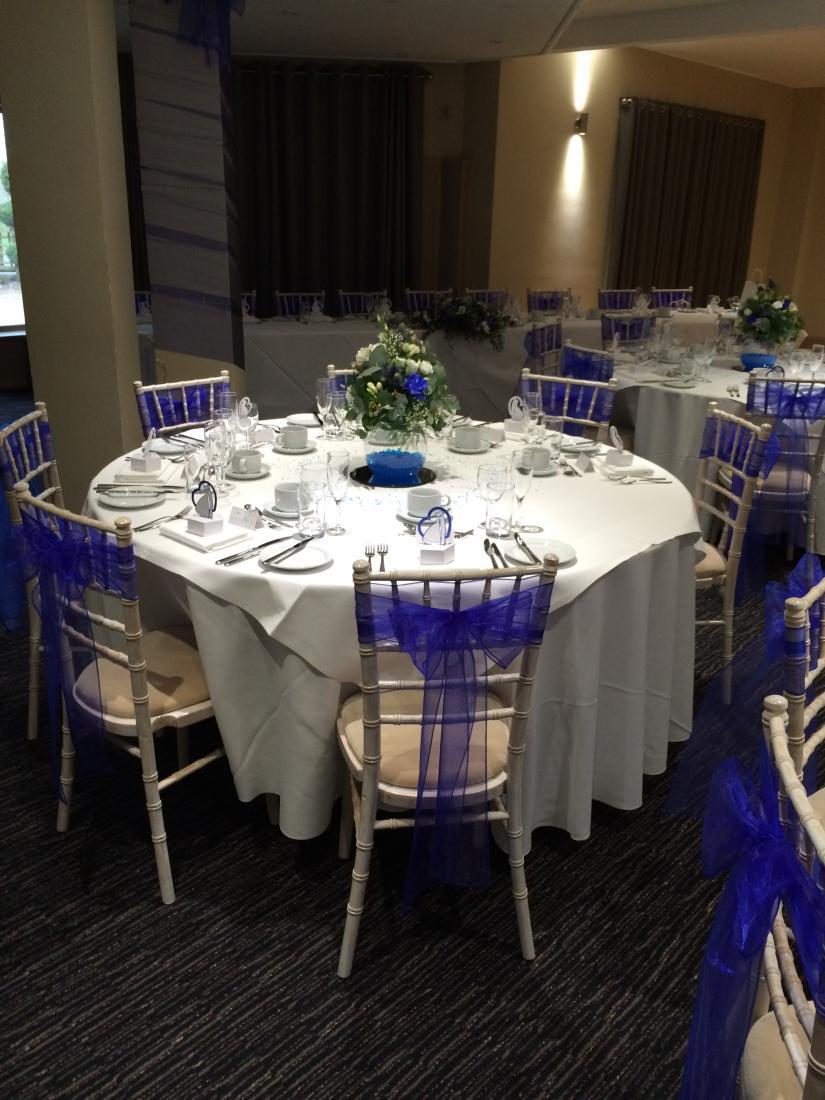 royal blue sash on limewash chiavari chair