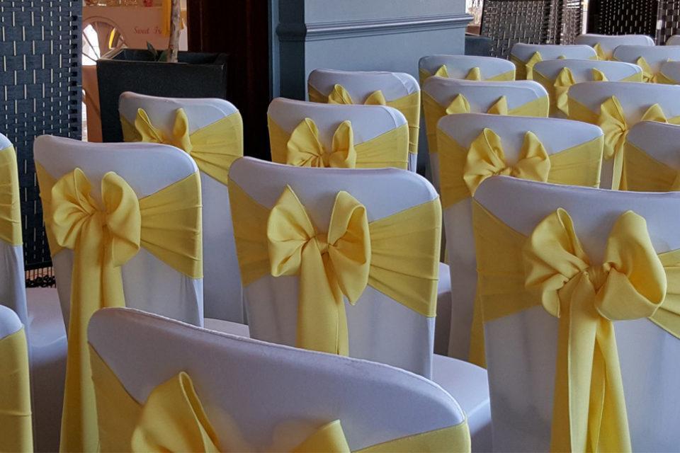 yellow satin sash on chair