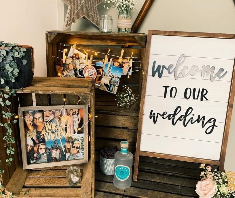 Wedding signs amongst photos in Norwich